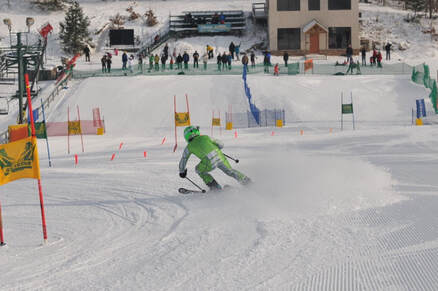 Picture of a ski racer skiing down the race course at Pine Knob Ski Resort.